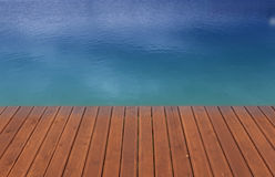 Wooden wharf and blue. Brown wooden wharf and blue water, holiday scene Royalty Free Stock Photos