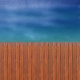 Wooden wharf and blue. Water Royalty Free Stock Photo