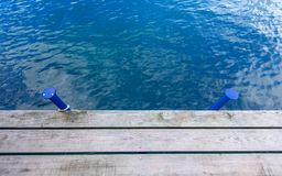 Wooden wharf and blue water Royalty Free Stock Photos