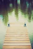 Wooden wharf and blue water Royalty Free Stock Image