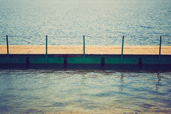 Wooden wharf and water Stock Photography