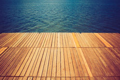 Wooden wharf and water Stock Photos