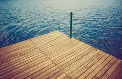 Wooden wharf and water Royalty Free Stock Photos