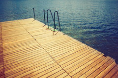 Wooden wharf and water Stock Images