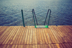 Wooden wharf and water Royalty Free Stock Image