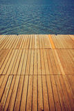 Wooden wharf and water Royalty Free Stock Images