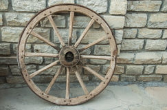 Wooden Wheel. On  brick wall Stock Photography