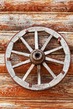 Wooden wheel from a cart Stock Image