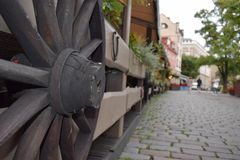 Wooden wheel of carts on the fence royalty free stock image