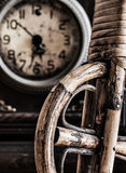 Wooden wheel on clock background Royalty Free Stock Image