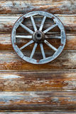 Wooden wheel hanging. On the wall Royalty Free Stock Images