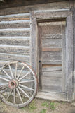 Wooden wheel and old doorway Stock Image