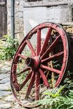 Wooden wheel in the old greek traditional village. Pretty village greek style - artwork in retro style Stock Images