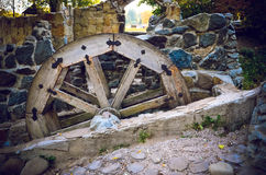 Wooden wheel of an old watermill on the river Stock Image