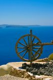 Wooden wheel in Santorini Stock Photos