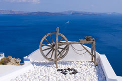 Wooden wheel on Santorini island, Greece Royalty Free Stock Images