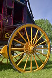 Wooden wheel of a stagecoach Stock Photography