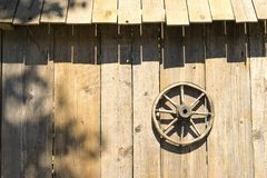 Wooden wheel on the wall of the barn Stock Images