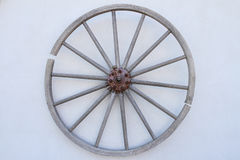 Wooden wheel on the wall. Old wooden wheel on the wall Royalty Free Stock Photography