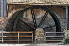 Wooden wheel of water mill Royalty Free Stock Images
