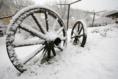 Wooden wheel in winter Stock Image