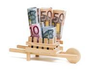 Wooden wheelbarrow with bills Stock Photo