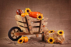 Wooden wheelbarrow decoration Stock Images