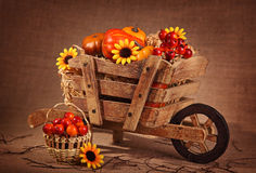 Wooden wheelbarrow decoration Stock Photography