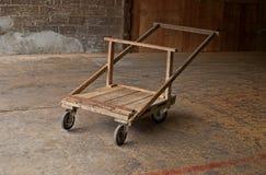 Wooden wheelbarrow. Old wooden wheelbarrow in the factory Royalty Free Stock Photography