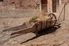 Wooden wheelbarrow Stock Image
