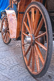 Wooden wheels on an old carriage. Stock Photo