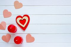 Wooden white background with red hearts and candles. The concept of Valentine Day. Top view stock photos
