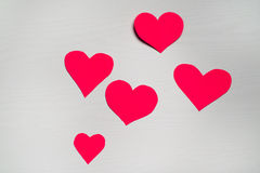 Wooden white background with red hearts. The concept of Valentin. E Day Royalty Free Stock Photography