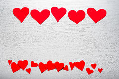 Wooden white background with red hearts. The concept of Valentin. E Day Royalty Free Stock Photo