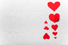 Wooden white background with red hearts. The concept of Valentin. E Day Stock Photo