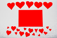 Wooden white background with red hearts and red leaf paper. The. Concept of Valentine`s Day Stock Images
