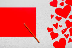 Wooden white background with red hearts and red leaf paper. The. Concept of Valentine`s Day Royalty Free Stock Photo