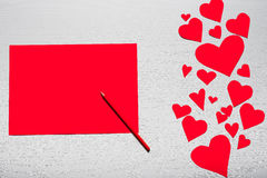 Wooden white background with red hearts and red leaf paper. The. Concept of Valentine`s Day Royalty Free Stock Photos