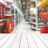 Wooden white balcony on blur of inside tools department store ba. Ckground Royalty Free Stock Photos