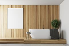 Wooden and white bathroom, tub and poster. Wooden and white bathroom interior with a concrete floor, a round white tub, and a poster hanging on the wall. 3d royalty free illustration