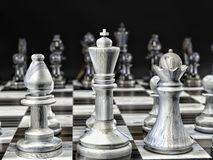 Wooden white and black chess pieces. 3D render of wooden set of white and black chess pieces on chess board with black background Royalty Free Stock Photos