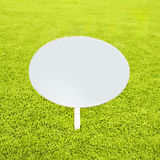 Wooden white blank sign on grass Stock Photo