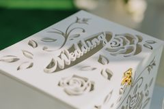 Wooden white box for wedding gifts. Wooden white box with drawings for wedding gifts stock image
