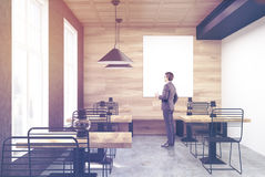 Wooden and white cafe, vertical poster, man Stock Images