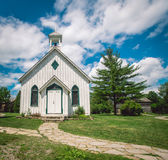 Wooden white chapel. Stone path leading to a wooden white chapel in Ontario Stock Images