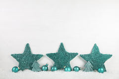 Wooden white christmas background with mint green stars. Wooden white christmas background with mint green stars - shabby chic style royalty free stock photography