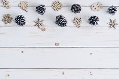 Wooden white and christmas background with snowflakes, pine cone royalty free stock image
