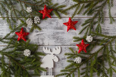 Wooden white christmas deer decoration on wooden background. Chi Stock Photography