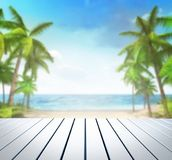 Wooden white deck with tropical palms background Royalty Free Stock Image