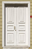 Wooden white front door royalty free stock photography
